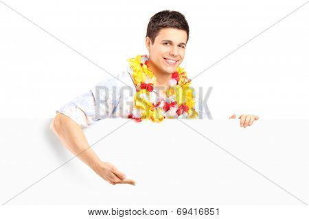 Young man with lei around his neck behind a panel isolated on white background