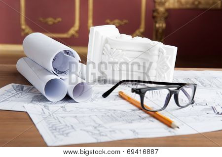 Portrait of spectacles, yellow pencil, design drawing and white