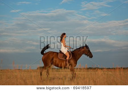 Girl Riding A Horse In The Field