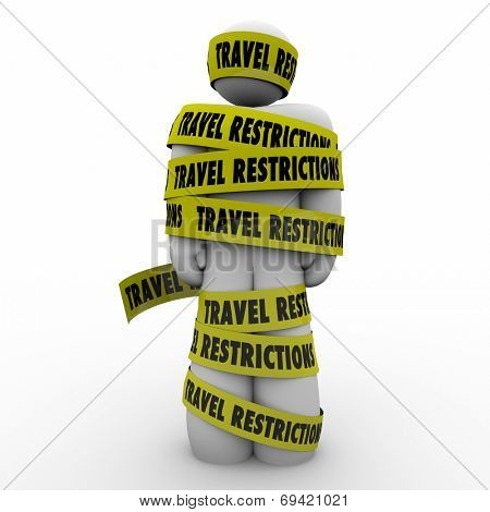 Man wrapped in yellow tape reading Travel Restrictions warning of dangers or risks in visiting hazardous areas