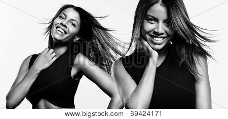 Two Black Woman With A Fluttering Hair