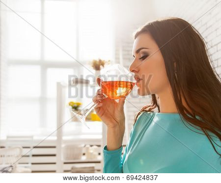 Beautiful Woman Tasting A Glass Of Rose Wine