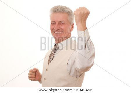 Closeup Of A Smiling  Business Man Pointing Upwards On White