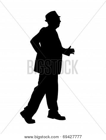 Silhouette of a Man Walking Fast