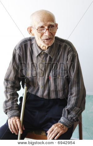 Senior Man Sitting On Chair