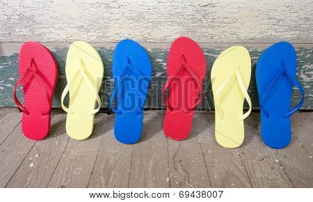 Multi Colored Flip-flops On The Porch