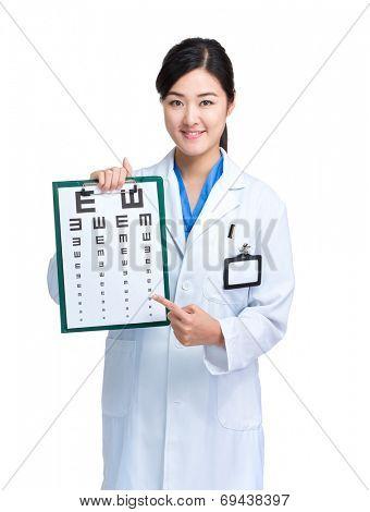Asian female optometrist show eye chart