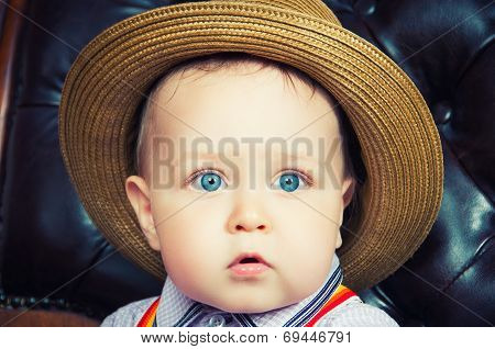 Small Baby Gentleman In A Hat, Close-up Portrait
