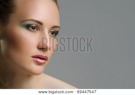Make-up. Beautiful model with green make up