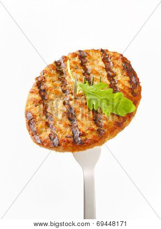 Grilled patty on a fork