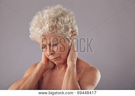 Senior Woman In Discomfort With Sore Neck