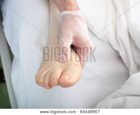 Doctor Examines Foot Of Patient