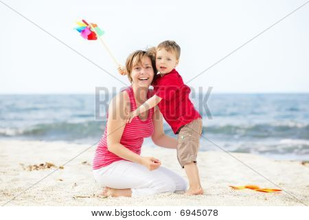 Mother and son having fun on the beach.