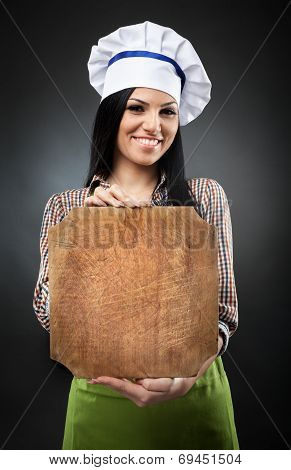 Woman Cook Holding A Board With Copyspace