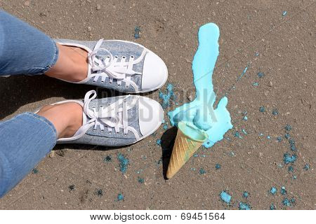 Ice cream fell on asphalt top view