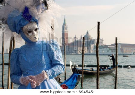 blue mask from venice carnival  and san giorgio church