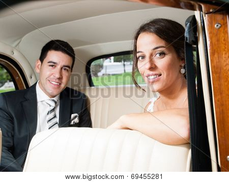 Bride And Groom In A Classic Car