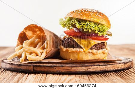 Delicious hamburger served on wood. Isolated on white background