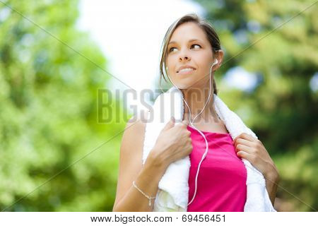 Active woman doing fitness at the park