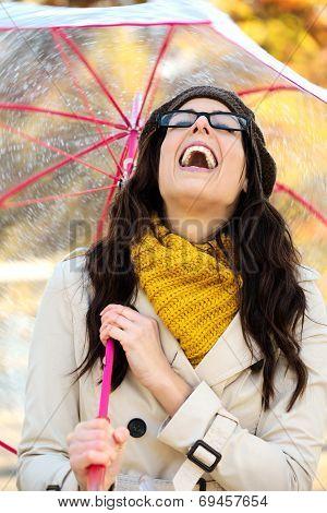 Woman With Umbrella Having Fun In Autumn