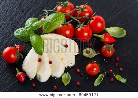 View From Above Of Tomatoes With Mozzarella And  Spices
