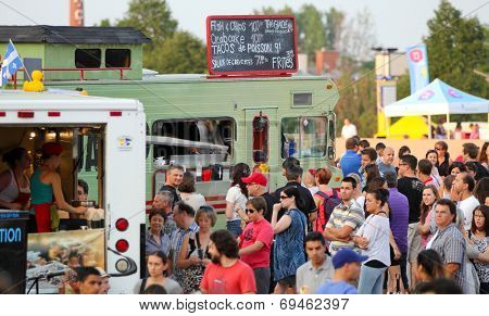 MONTREAL, CANADA - AUGUST 01: More than 40 food trucs on the esplanade Financiere Sun Life for the event  first friday of the month on august 01 in Montreal, Canada.