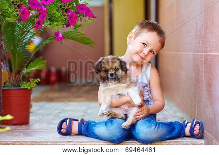 Young Boy Hugging Little Puppy