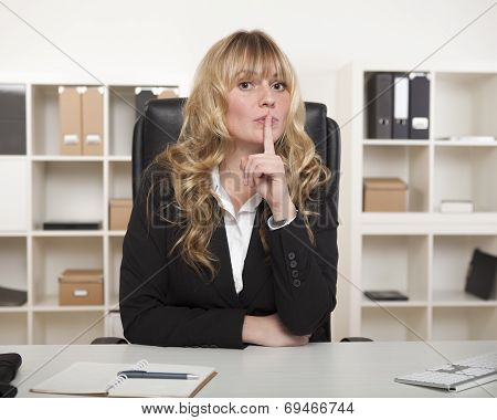 Attractive Businesswoman Asking For Silence