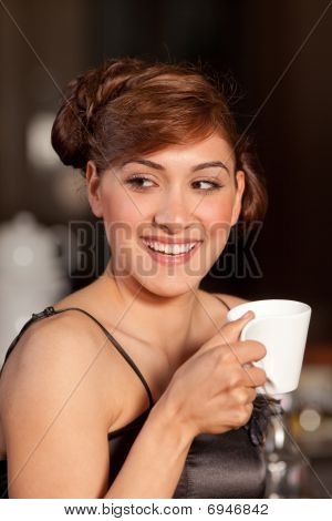 Beautiful Young Woman Drinking Coffee At Bar Smiling