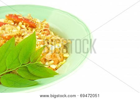 Close Up Green Papaya Salad With Leaves Of Gooseberry Isolated