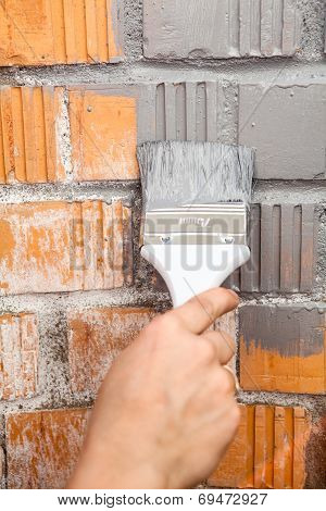 Orange Brick Wall Painted With Grey Color