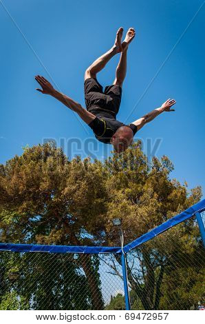 A Man Jumping On A Trampoline
