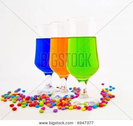 Multi-coloured Cocktails In High Glasses On A White Background