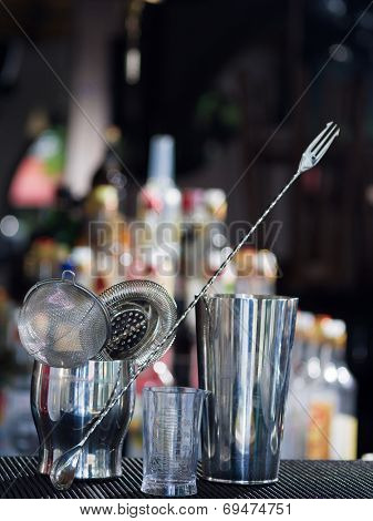 Bartender tools at the club over dark background - selective focus