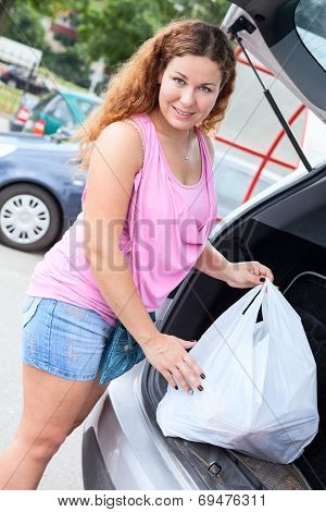 Portrait Of Young Woman Shopper After Mall