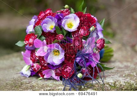Wedding bouquet. Bouquet of fresh flowers for the wedding ceremony. Bouquet of colorful flowers on n