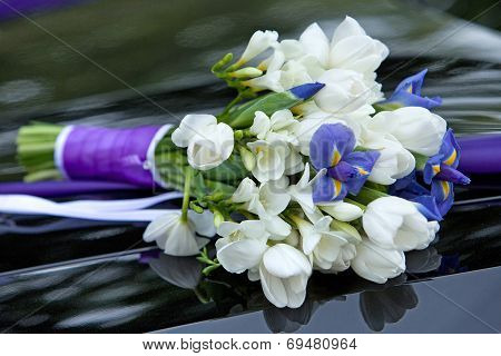 bouquet of flowers blue and white colors of irises and tulips for the wedding