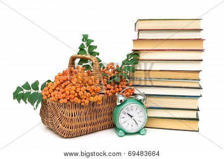 Rowan Berries, Books And Clock Alarm Clock On A White Background