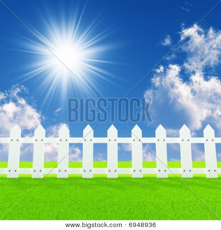 white fence on a summer lawn