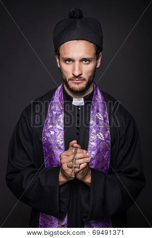 Humble priest with Christian Cross
