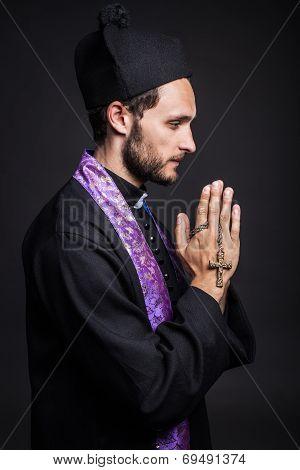Praying priest
