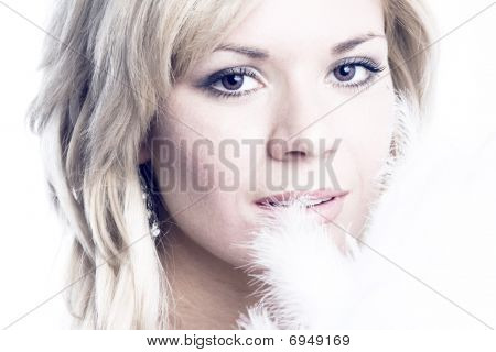 Close-up Of Beautiful Woman With White Feather