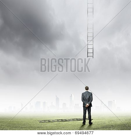 Rear view of businessman and broken ladder to sky