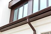 stock photo of gutter  - Rain gutter and downspout on the house