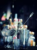 picture of over counter  - Bartender tools at the club over dark background  - JPG