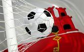 image of gibraltar  - Gibraltar flag and soccer ball football in goal net - JPG