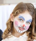 image of face painting  - portrait of a pretty caucasian girl with blue eyes with her face painted as a bunny rabbit - JPG
