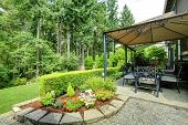 picture of gazebo  - Backayrd with gazebo patio area and beautiful landscape design - JPG