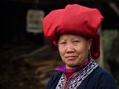 pic of traditional attire  - Woman from Red Dao minority group wearing traditional attire and headdress at Giang Ta Chai village - JPG