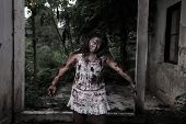 foto of terrific  - The scary Zombie Girl In Haunted House - JPG